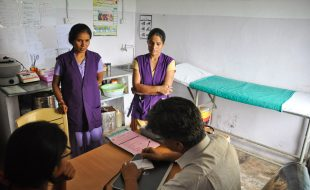 Image of BHS team members discussing a case in Manpur